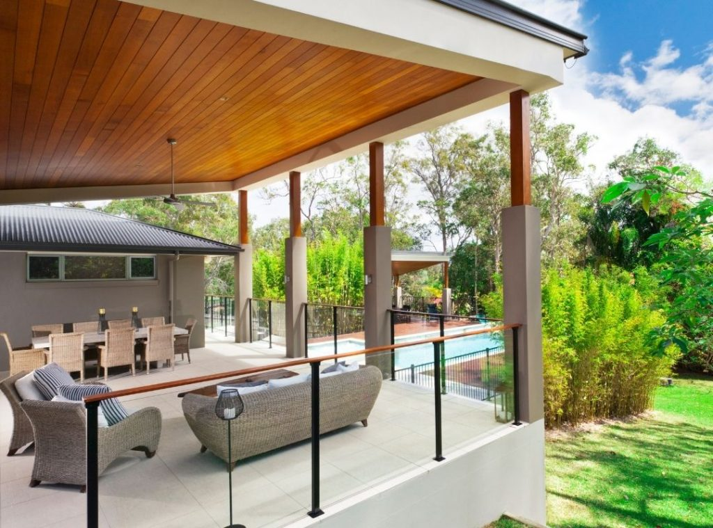 Beautiful backyard with a pool | Featured image for Backyard Extension Ideas blog.
